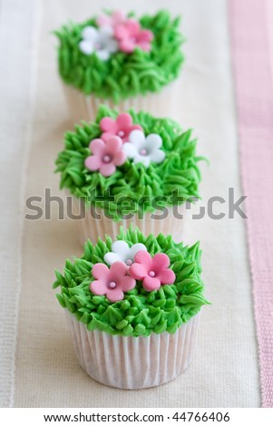 Flower garden cupcakes - stock photo