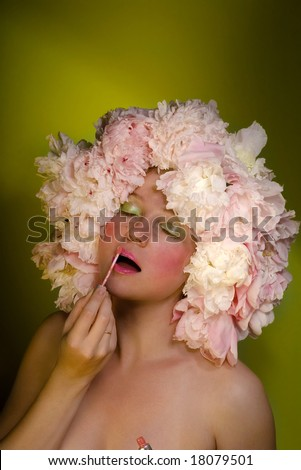 Flower girl with a lipstick - stock photo