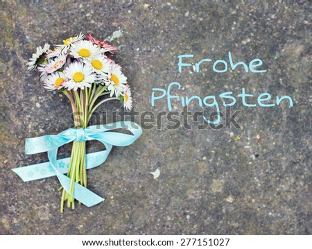 flower greeting card background - german for happy pentecost - stock photo