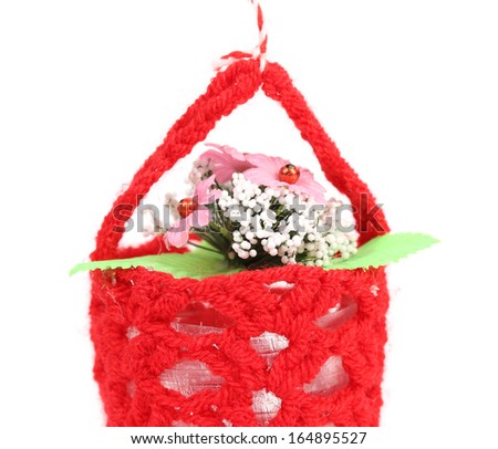 Flower in a basket. Isolated on a white background. - stock photo