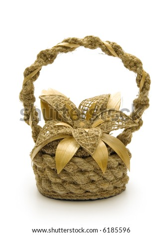 Flower in a basket, isolated on white background - stock photo
