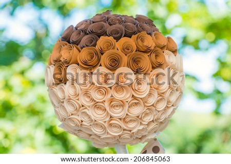 flower made �¢??�¢??of paper with a bow on a stick in pea - stock photo