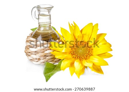 Flower of a sunflower and small bottle with the vegetable bridge on a white background - stock photo