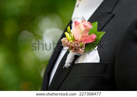 Flower on husband suit - stock photo