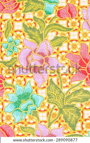 flower pattern background on batik fabric thai style. - stock photo