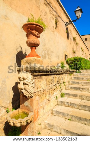 Flower pot steps medieval old town, Palma de Mallorca, Spain - stock photo