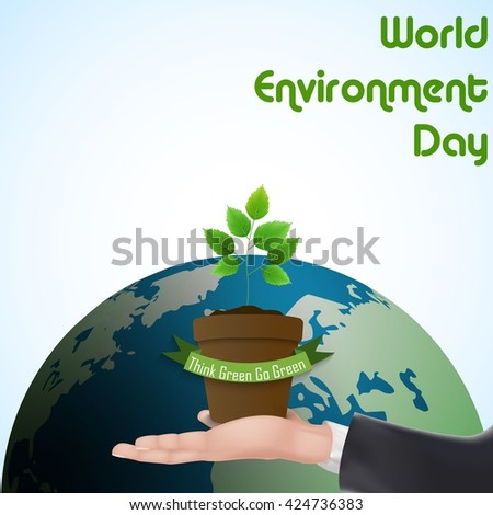 Flower Pot with green ribbon concept over hand for world environment day - stock photo