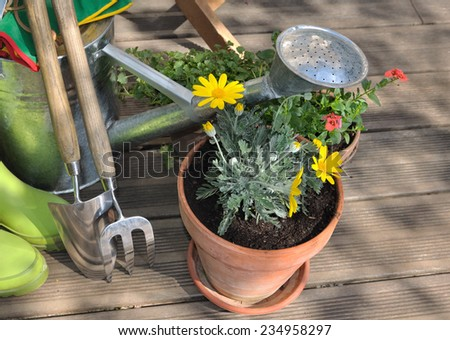 flower pots and gardening accessories in terrace - stock photo