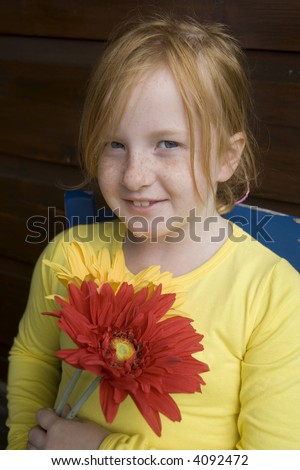 flower power from a little girl with freckles - stock photo