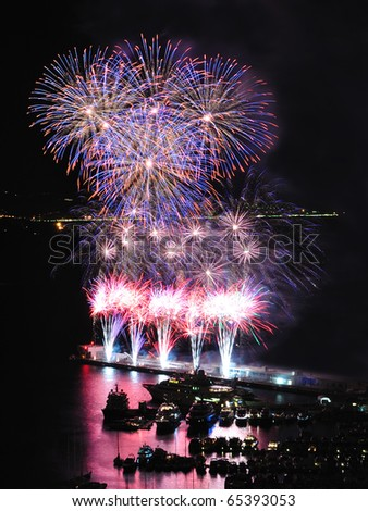 Flower shaped fireworks in Monte Carlo harbor - stock photo