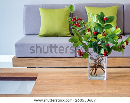 Flower vase on table-top with sofa/ minimalist modern interior Living room - stock photo