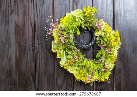 Flower wreath isolated on  vintage wooden background - stock photo
