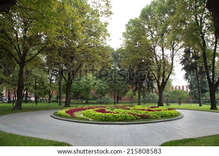 Flowerbed with circle walkway in a Formal Garden - stock photo