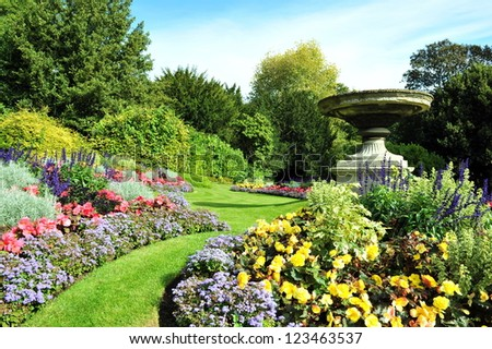 Flowerbeds and Winding Pathway in an English Formal Garden - stock photo