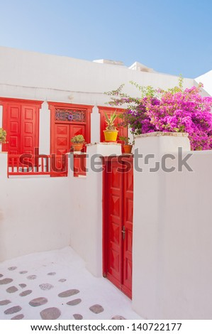Flowering bougainvillea around the building on the island of Mykonos in Greece - stock photo