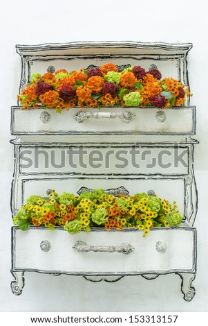 flowerpot with plants on wall - stock photo