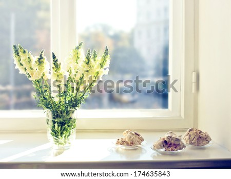 Flowers and cakes at early morning - stock photo