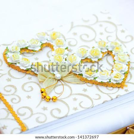 Flowers and frame on vintage of book Wedding - stock photo