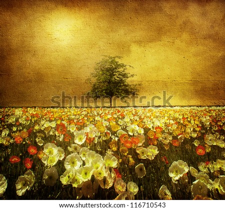 Flowers and lone tree - stock photo