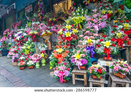flowers at farmers' market in Thailand - stock photo