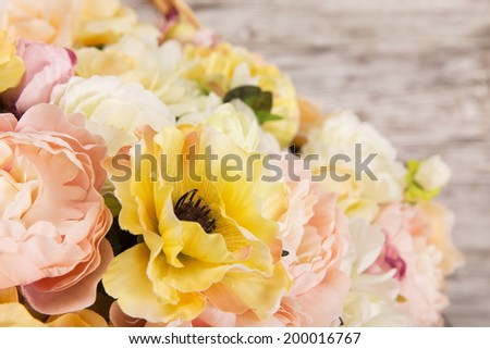Flowers bouquet over wooden background  - stock photo