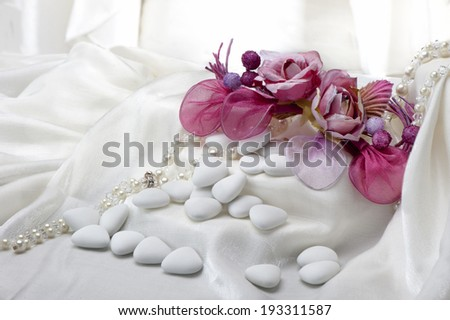 flowers candy and weddings favors on white background - stock photo