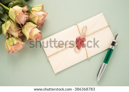 Flowers, envelope and pen   - stock photo