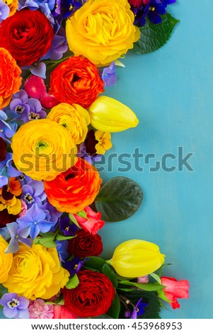 Flowers festive flat lay composition on blue wooden table - stock photo