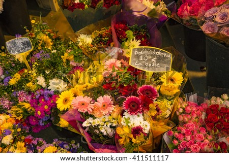 Flowers for sale in Paris shop, with labels showing euros - stock photo