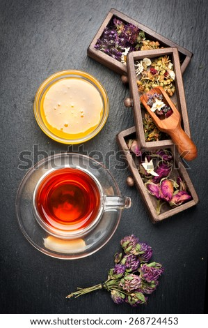 Flowers herbal tea with honey and dried herbs and flowers. top view - stock photo