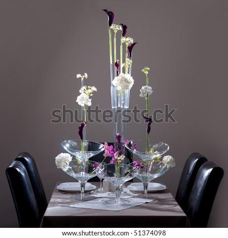 Flowers (Hydrangea, Orchidaceae, Kala) arrangement on the table - stock photo