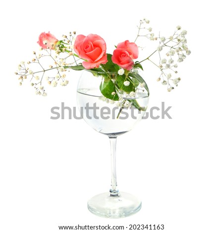 Flowers in a glass on the white background - stock photo