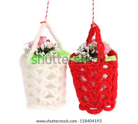 Flowers in white and red baskets. - stock photo