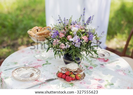 Flowers of lavender on the dining table outdoors - stock photo