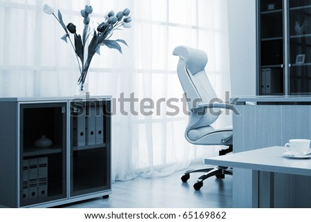 Flowers on a background of a window at modern office - stock photo