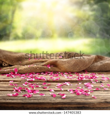 flowers on table in garden  - stock photo