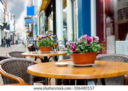 Flowers on the tables of street cafes. Gorinchem. Netherlands - stock photo