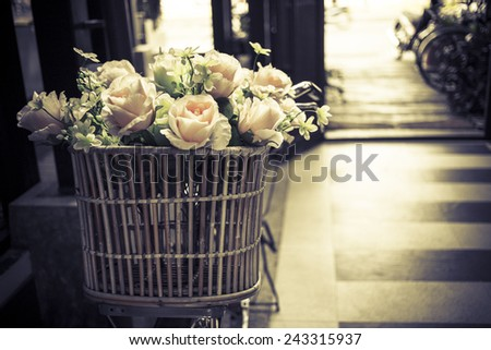 Flowers on vintage bicycle - stock photo