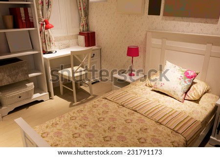 flowers pattern on single bed, soft light for relaxing - stock photo