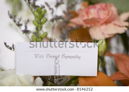 Flowers sent with a note of sympathy - stock photo