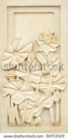 Flowers, stone sculpture - stock photo