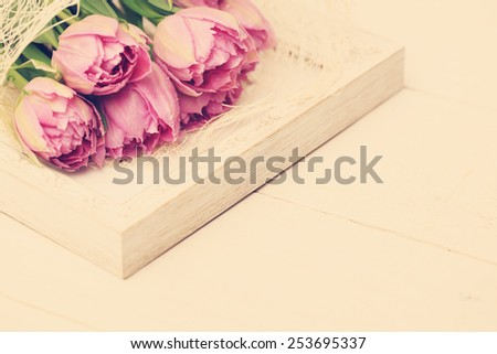 Flowers tulip with water drops and white vintage border - stock photo