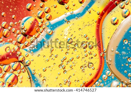 Flowing and liquefying. Macro photography in the studio, oil and water, lights and reflections. - stock photo