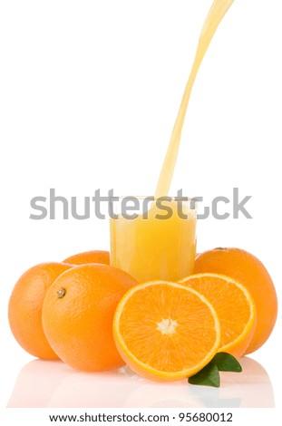 flowing juice and orange isolated on white background - stock photo