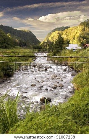 Flowing River In Rural Panama - stock photo