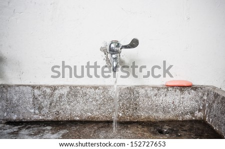 flowing water from tap - stock photo