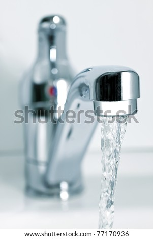 Flowing water from the tap - stock photo