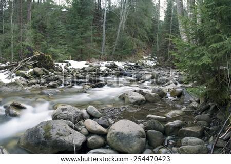 Flowing water of Carpathian mountain stream - stock photo