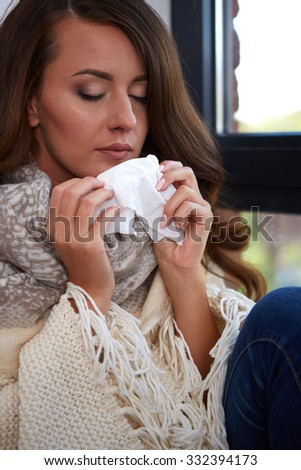 Flu. Closeup image of frustrated sick woman with red nose  - stock photo