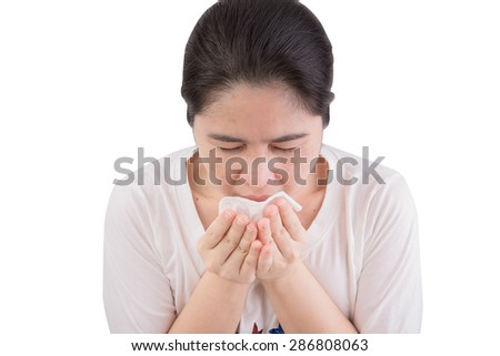 Flu cold or allergy symptom. Sick young woman girl sneezing in tissue on white background. Health care. Studio shot. - stock photo
